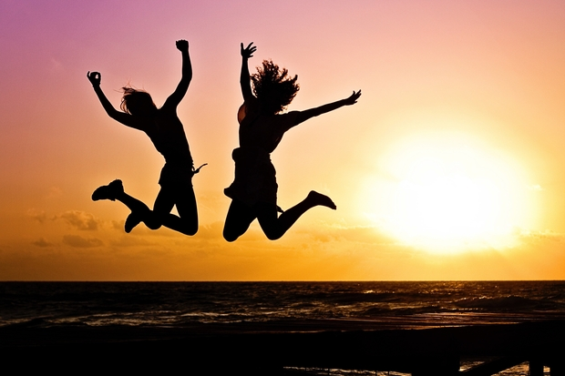 Two Person Jumping in Silhouette Photography