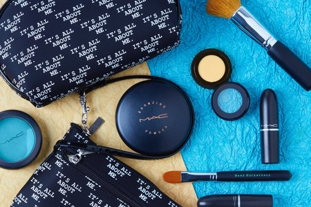 assorted make-up products against a yellow and blue background