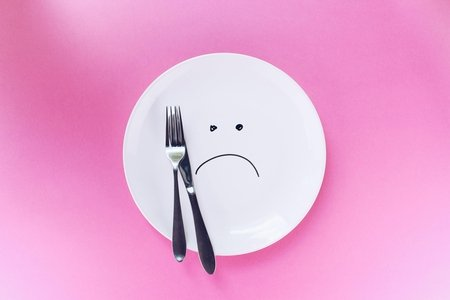 a dish with sad face