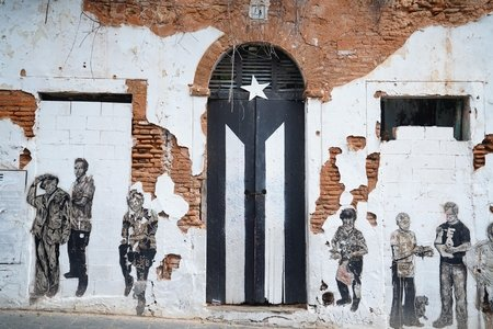 door with painted flag in San Juan, Puerto Rico