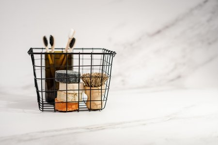 black basket with compostable toiletries
