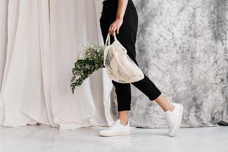 Woman with reusable grocery bag