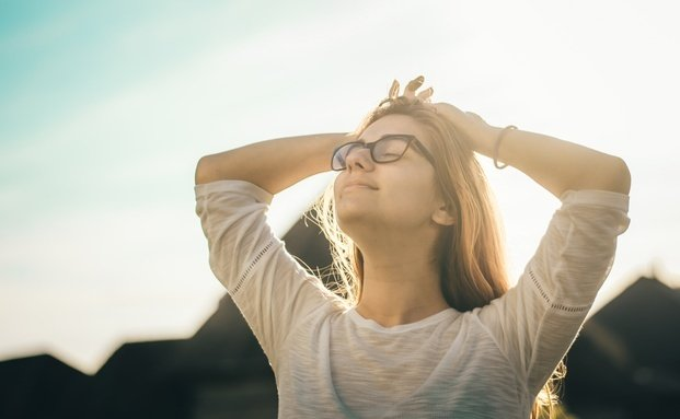 person stretching outside in sun