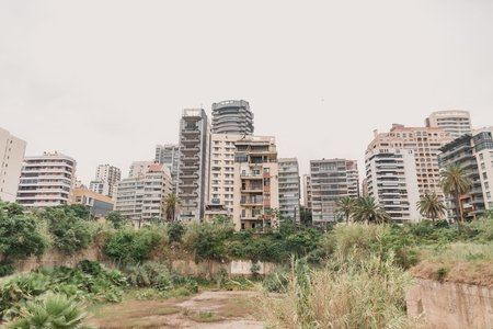A photo of Beirut, Lebanon, facing the edge of the city from a field