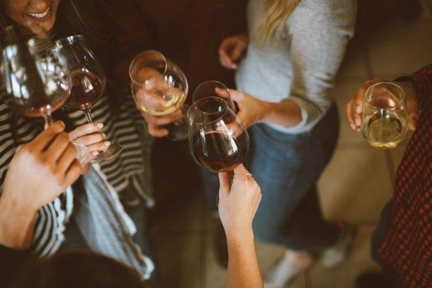 Girls clinking wine glasses