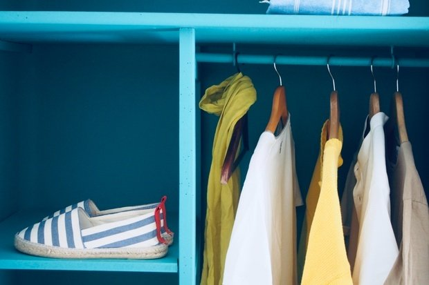 blue shelf with a pair of shoes on it