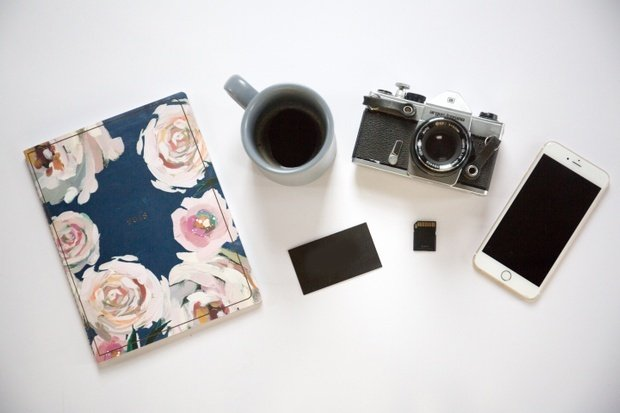 notebook, coffee, film camera