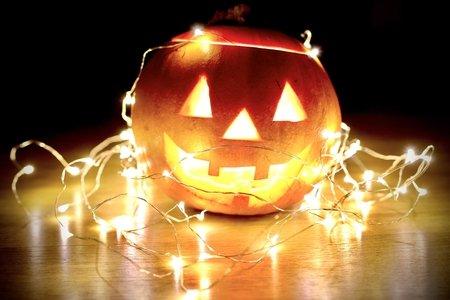 string lights wrapped around pumpkin