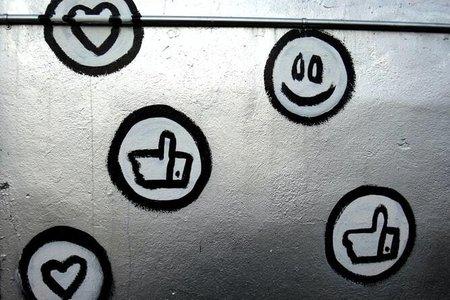 Emoji Graffiti on silver wall