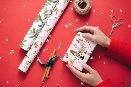 Gift held in hands with wrapping paper