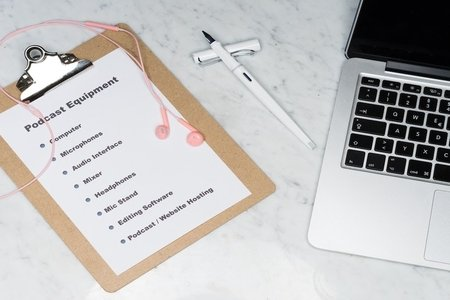 Clipboard with list and laptop