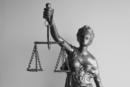 black and white photo of Lady Justice holding the scales of justice