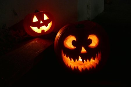 two lighted Jack-o-Lanterns