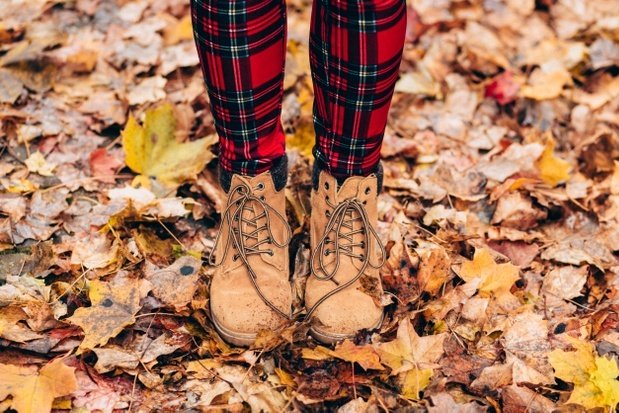 fall boots in fall leaves with plaid pants