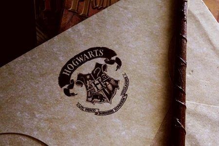 Hogwarts symbol on paper