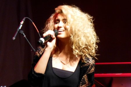 Singer Tori Kelly with microphone