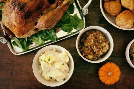 Thanksgiving meal spread with turkey and sides