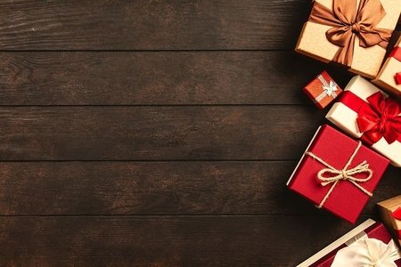 presents on the right side of the picture, on a wooden floor